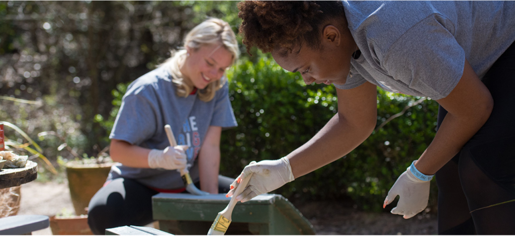 Freshening Up - Freshmen Brittney Battle (left) and London Smith clean, scrape and paint lawn chairs during this year 2019.03.26